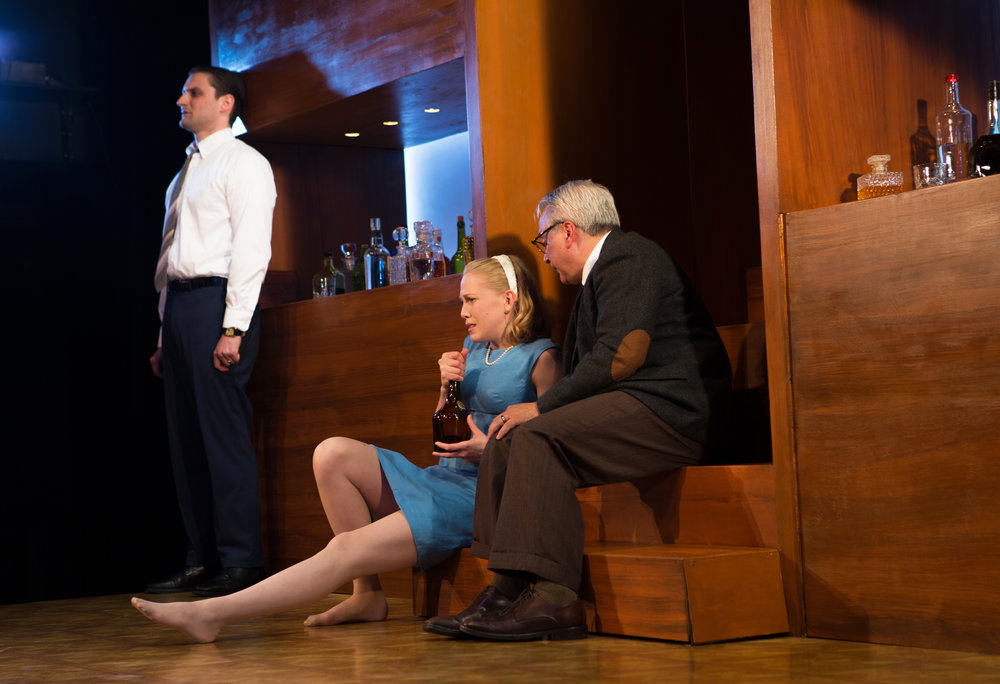 """Director Mark Jackson's  Woolf  is deliciously big and bad indeed... Without so much as a bench or stool, the actors are forced to sit on the floor, lean against the sides of the stage or crowd the stairs. The sheer amount of crouching and drinking that goes on does much to heighten the play's intense emotional discomfort...""     THE DAILY CALIFORNIAN"