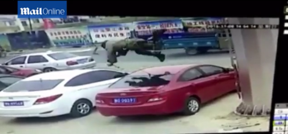 man falls from roof lands on car