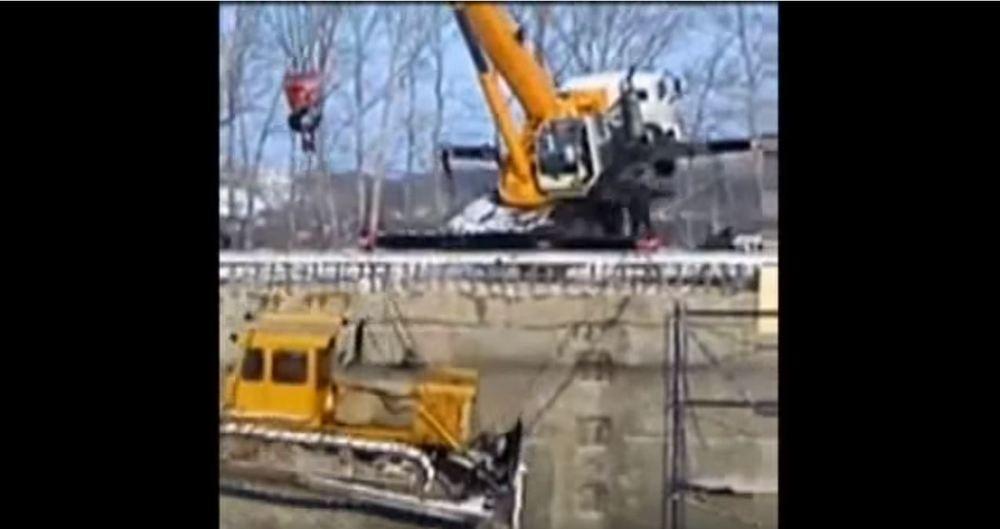 crane and bulldozer fail
