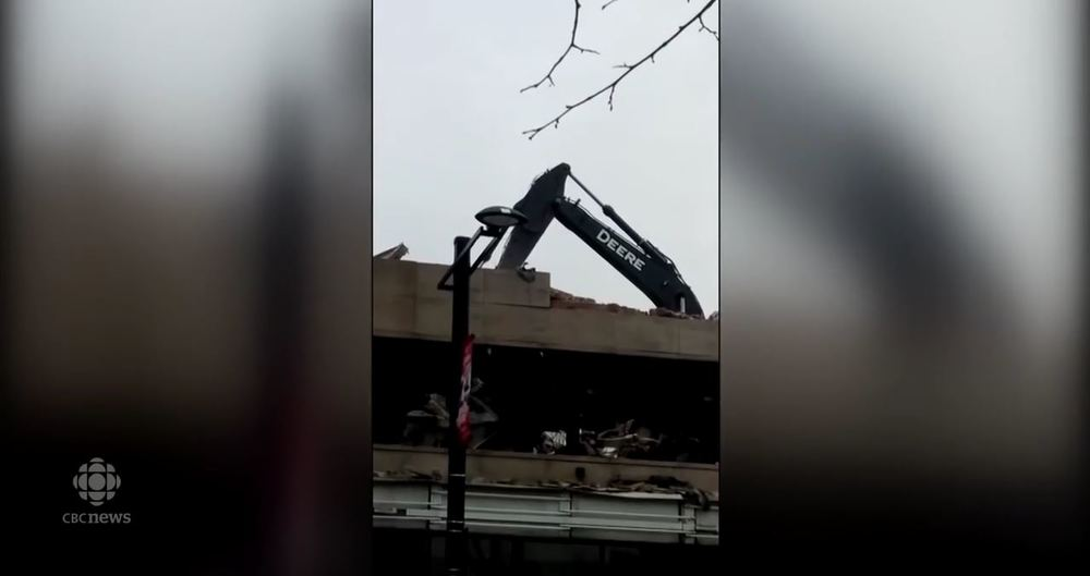 excavator falls through floor
