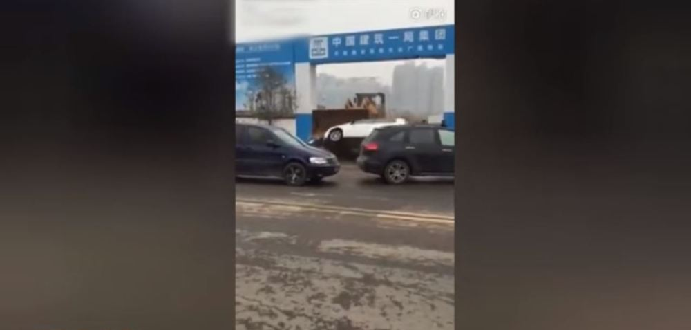 wheel loader crushes cars