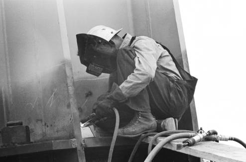 Welder_working_on_Space_Needle_leg_ca_July_1961.jpg