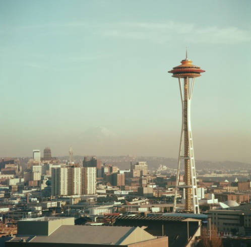 View_south_to_Space_Needle_downtown_and_Mount_Rainier_1962.jpg