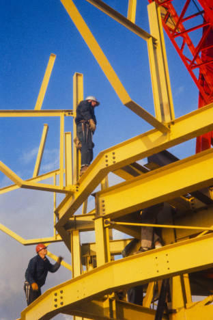 Workers_at_base_of_Space_Needle_torch_ca_December_8_1961 (1).jpg