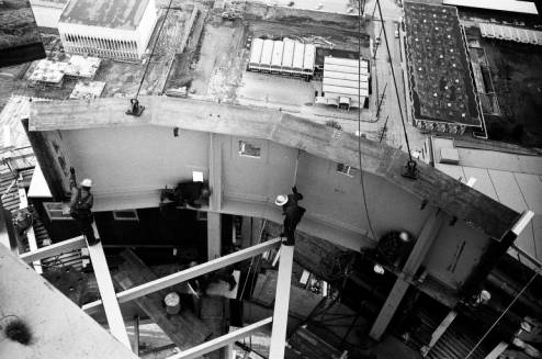 Workers_install_Space_Needle_ring_girder_with_Armory_below_ca_November_1924_1961.jpg