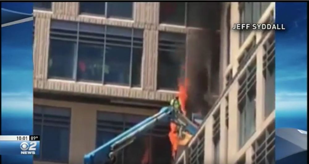 construction workers jump from burning lift