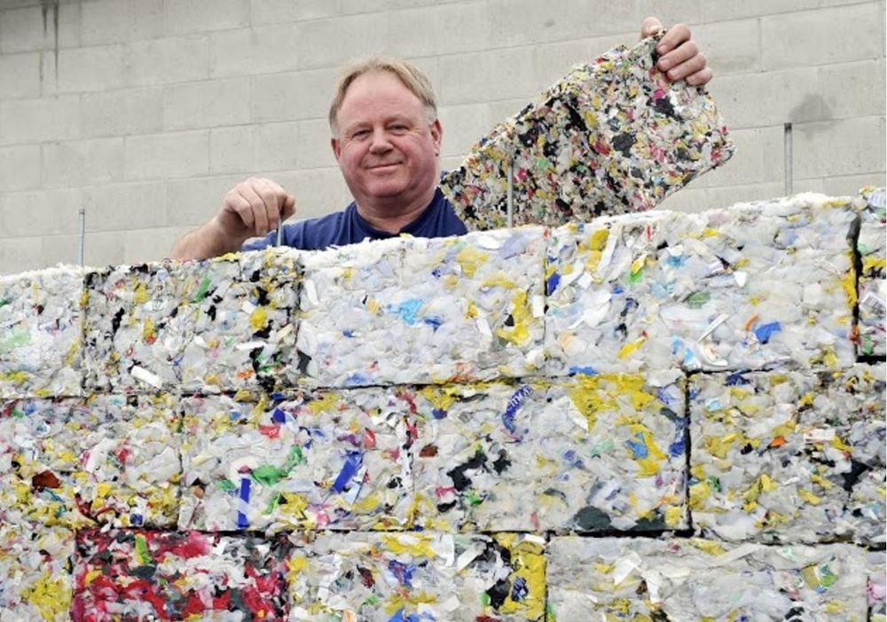 Principal Engineer with RePlast blocks made of recycled plastic.  Photo via ByFusion