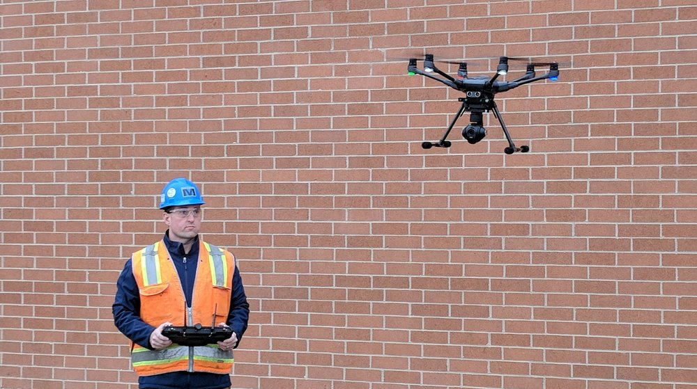 Jason Galoozis, Safety Director of FE Moran, flying a drone