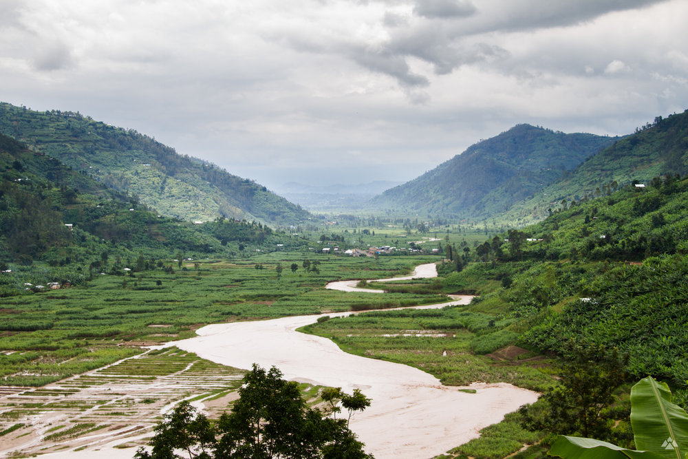 Views across the surrounding mountains of Shyira. Heavy rainfall had burst the banks of the river that meanders through.