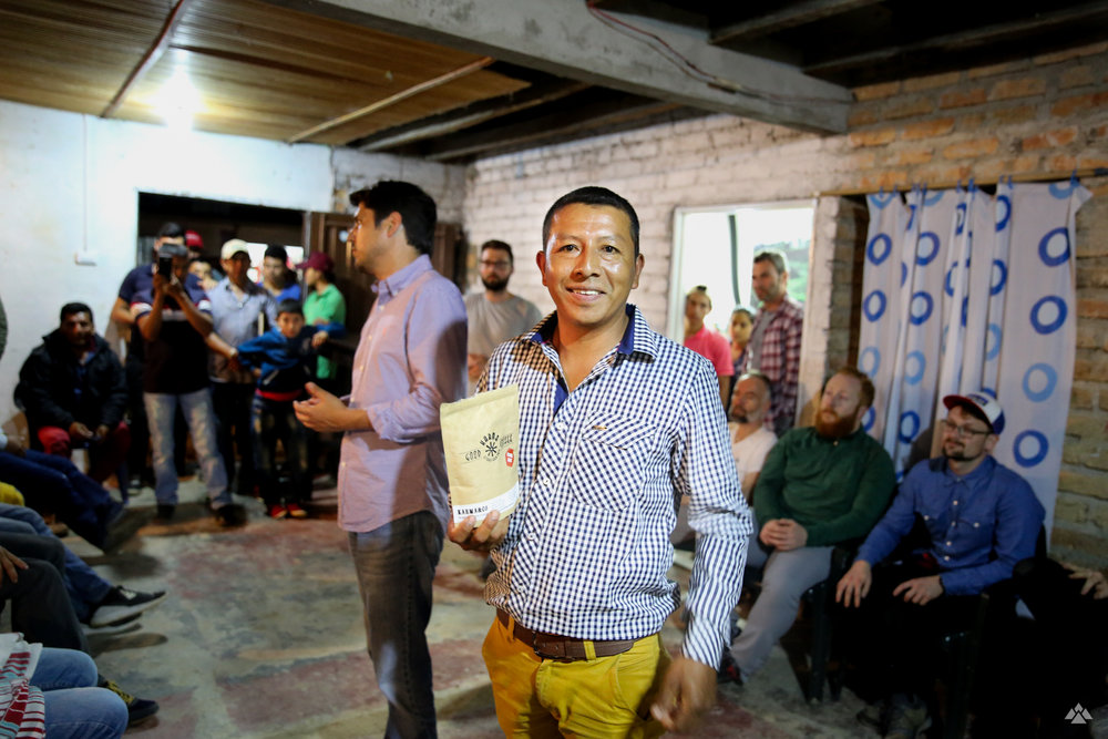 Mauricio Benavidez, head of El Carmen, receiving a bag of coffee purchased and roasted through the project by Good Karma, Germany.
