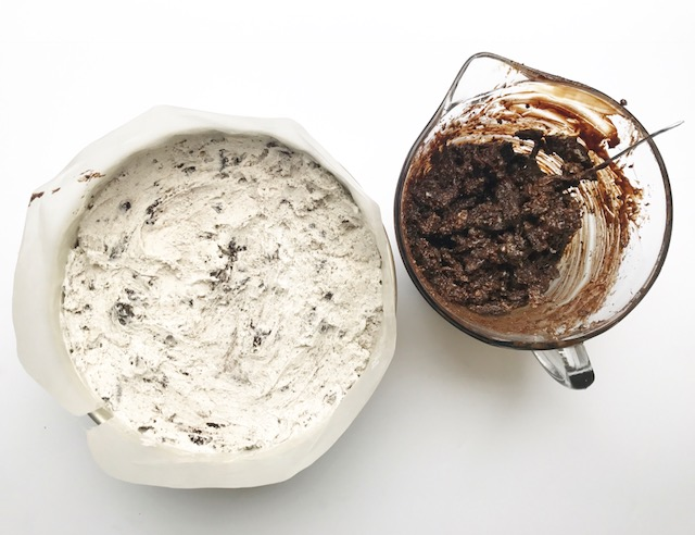 "Create another fudge-Oreo mixture and spread it over the Oreo ice cream layer. Return to the freezer.  After the cake has hardened, it's time to remove it from the pan. Place a plate or another cake board on top of the cake and flip it over and out of the cake pan. remove the bottom cake board and replace it with the 12"" board. Return to an upright position. Remove wax paper."