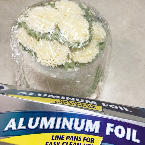 Step 4: Wrap the cake completely in aluminum foil. Alternately, you can also use an airtight container if you have one big enough. This will protect against any odor or flavors from other items in the freezer.