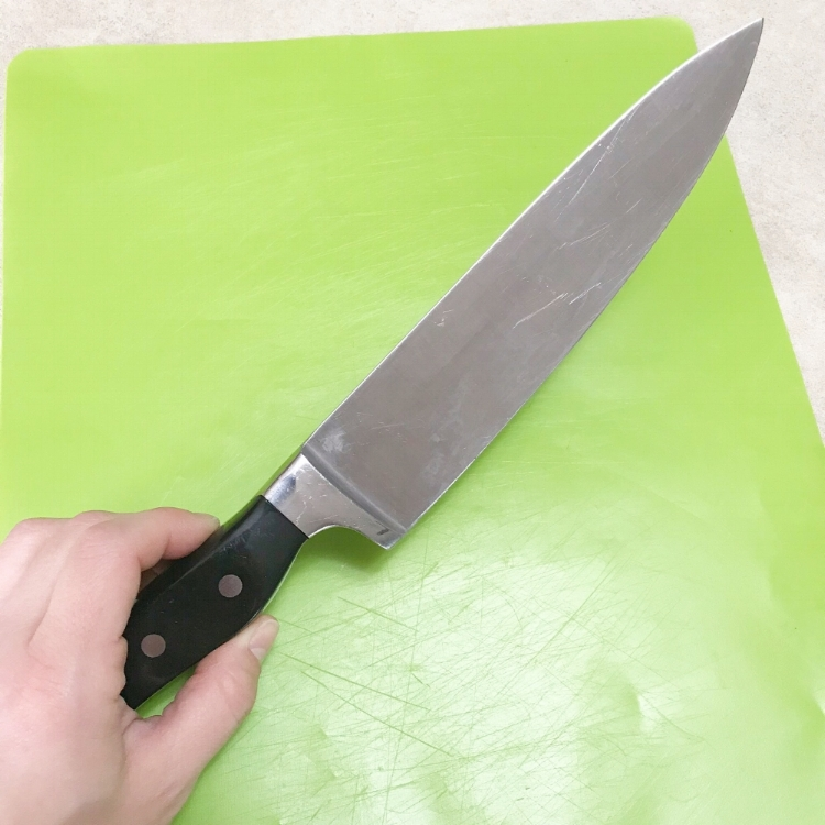 To do this technique, you'll need a long knife and, if available, a cutting board.