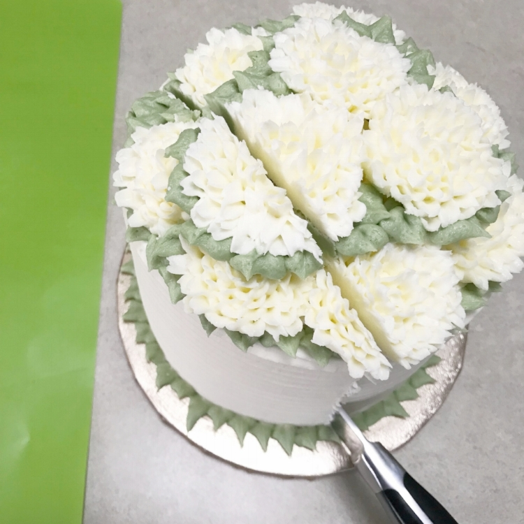 About 1.5-2 inches from the edge of the cake, cut it length wise all the way through.