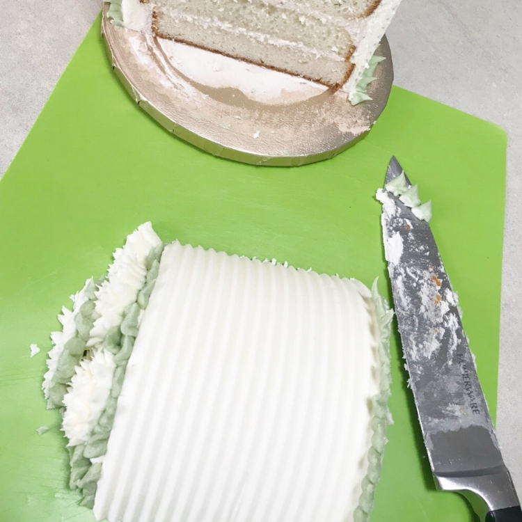 Move that portion of the cake to a cutting board.