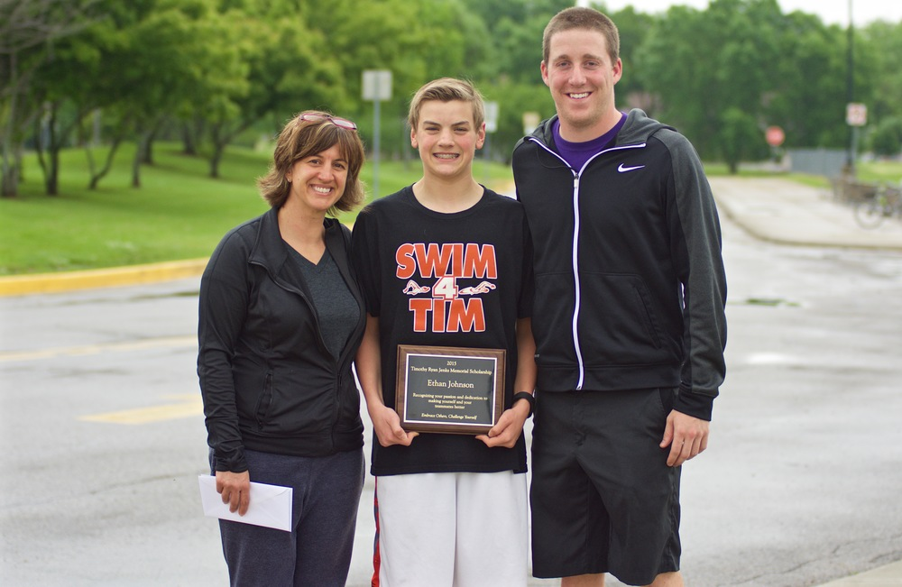 Ethan (center) and his mom, Mari Johnson and swim coach Dustin Rhoads.