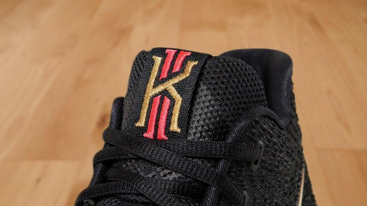 9a5f0430a72 ... Nike Swoosh logo on the sides. A mix of Red and Gold appears on the  Kyrie tongue tag, while sitting atop a speckled midsole and icy translucent  outsole.