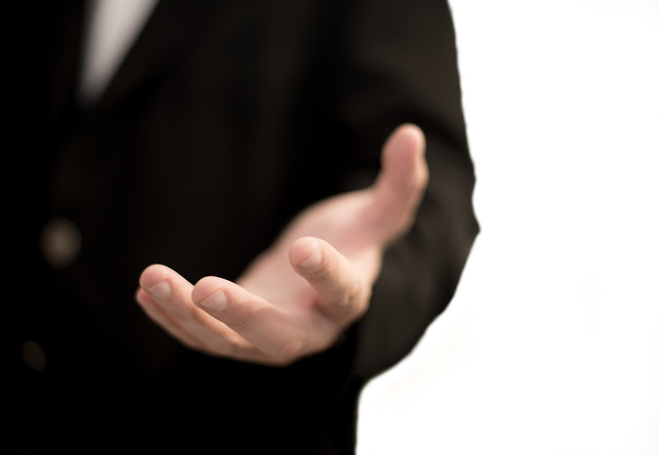"""The purpose of effective feedback is, above all else, to be helpful. """"Business man hand"""" by kev-shineis licensed under Creative Commons Attribution 2.0."""