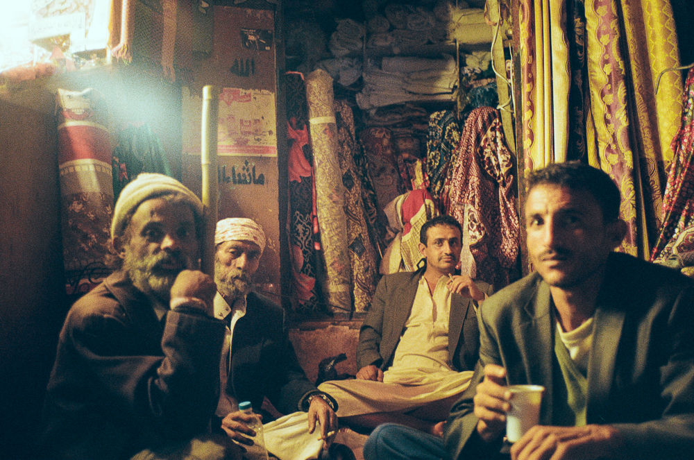 men outside the old souk in sana'a, YEMEN