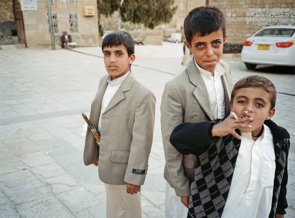 3 boys excited by the camera, shibam, YEMEN