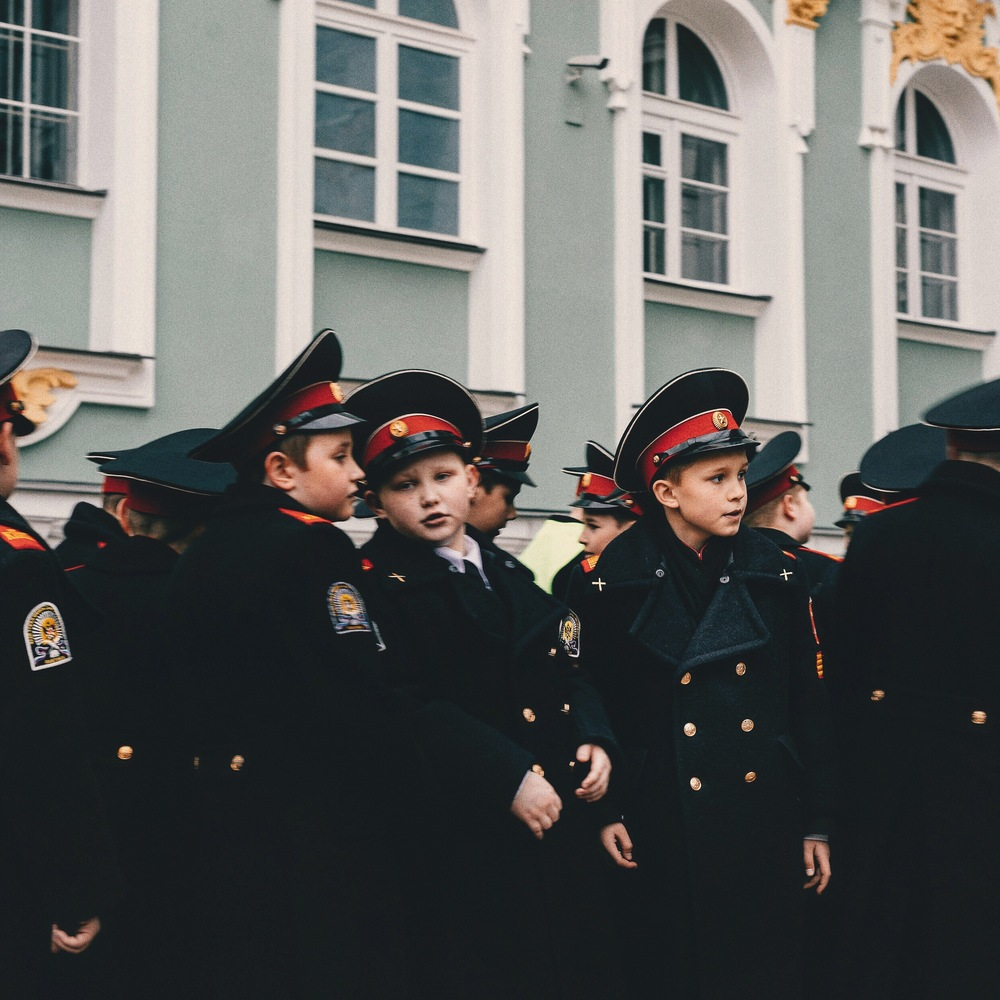 young russian boys line up for entrance to the winter palace, outside the hermitage museum    st. petersburg, russia