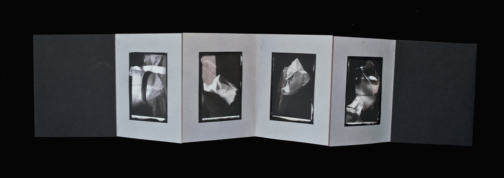 """Beauty of Black""  , My Garbage series  24"" X 5""  Accordion book, including four inkjet prints hand stenciled with opaque white substrate on black paper"
