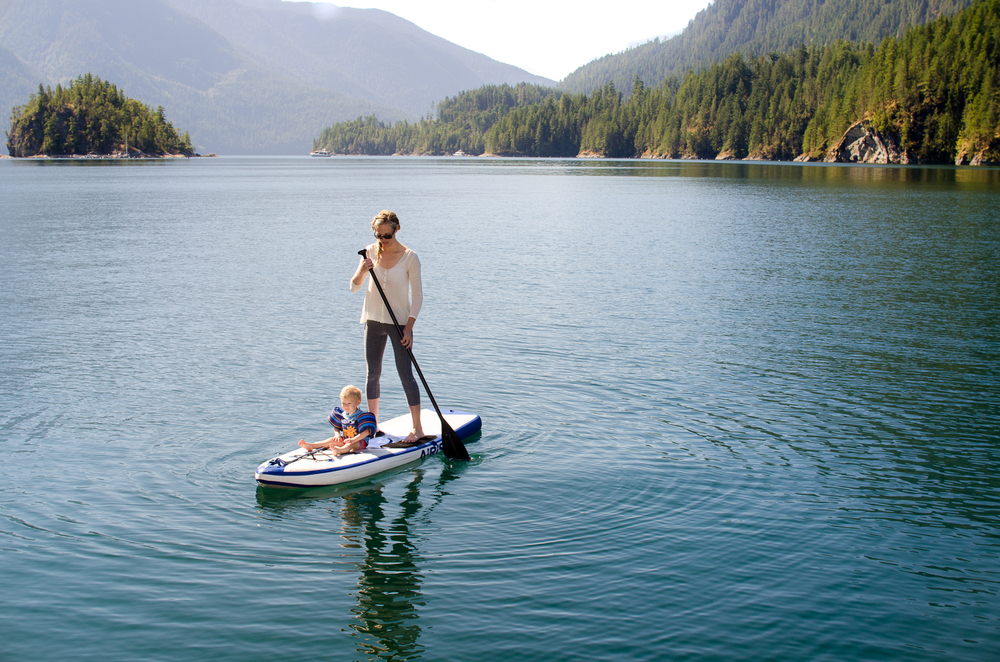 """SUP Paddleboarding in Pendrell Sound, British Columbia Canada. He sang """"row, row, row your boat"""" to me while we floated around."""