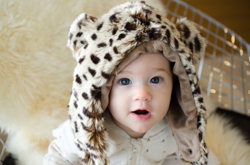 Apple is wearing the Eskimo Kids Cheetah Hat, which you can get for free on eskimokids.com by using our promo code! Image by Totes and the City