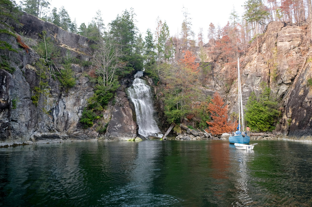 A sailboat drops anchor in front of Cassel Falls at Teakerne Arm Provincial Park.  Image by Totes and the City for Destination: Desolation 2017