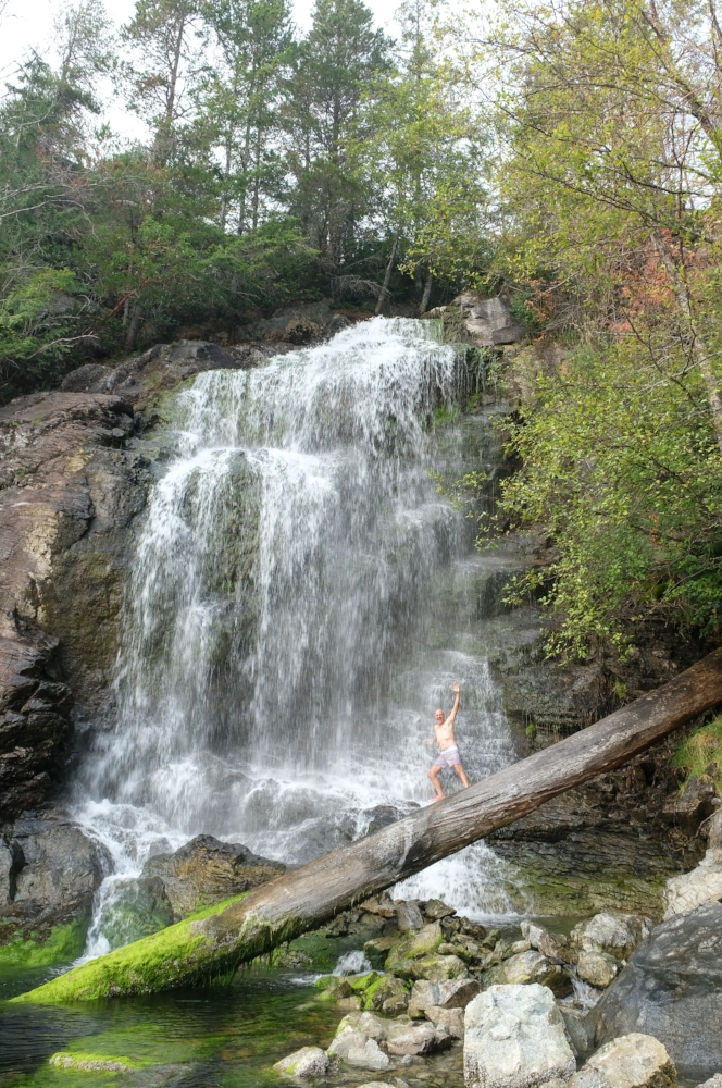Papa taking a shower under the waterfall of Cassel Falls at Teakerne Arm.  Image by Totes and the City for Destination: Desolation 2017