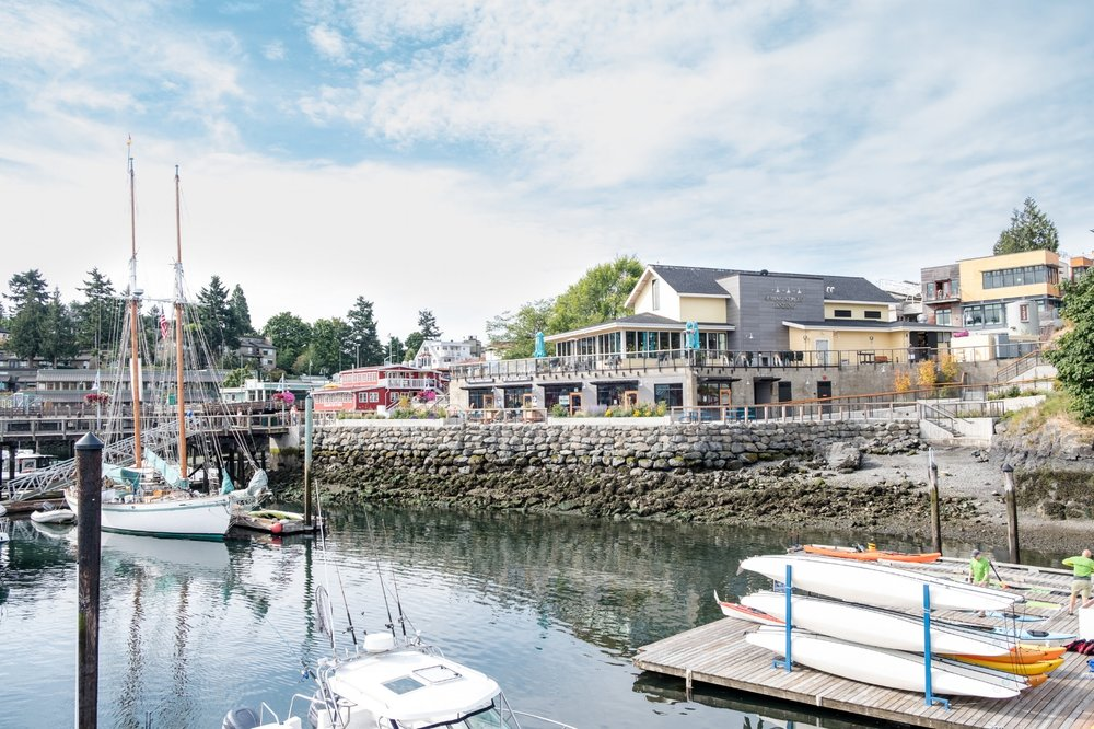 The recently remodeled waterfront and Downriggers Restaurant in Friday Harbor, WA.  Destination: Image by Totes and the City for Destination: Desolation 2017
