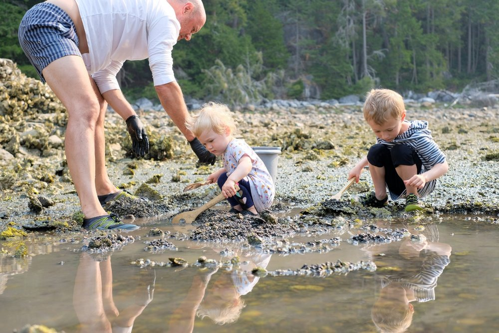 Digging for clams in Desolation Sound on Mink Island, BC Canada at low tide | Image by Totes and the City for Destination: Desolation