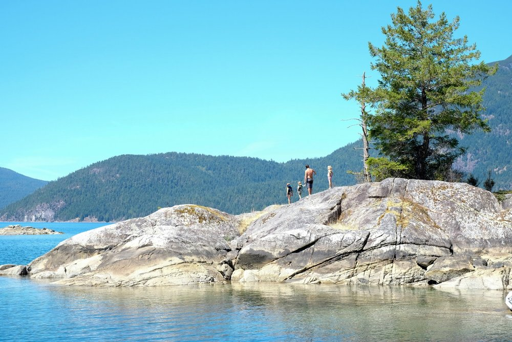 Walking along the rocks in Prideaux Haven and Laura Cove, a morning in Desolation Sound.  Image by Totes and the City for Destination: Desolation 2017