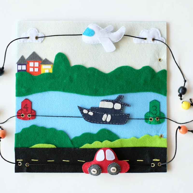 Page six of Apple's Quiet Book | transportation pull-string themed page with an Airplane, Boat and Car |Page six of six of my DIY quiet felt book project by Totes and the City