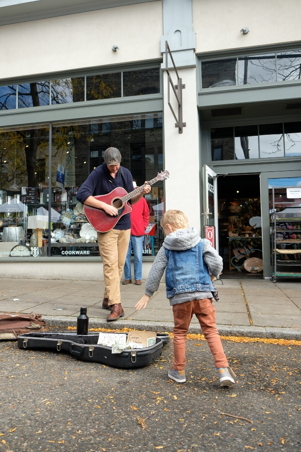 Totes throwing some cash in the guitar case for his enjoyment of the live music at the Ballard Farmer's Market