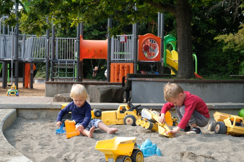 A large sandbox with toys is just next to the playground at Webster Park in the Ballard neighborhood of Seattle | Exploring Seattle by Totes and the City