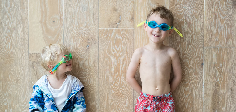 Totes is getting ready for his swim lessons at Swim Guru while Apple likes to copy anything he does, including wearing his swim goggles around the house.