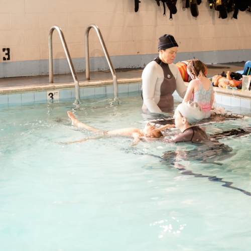 Totes floating during one of his swim lessons at Swim Guru with Coach Kat