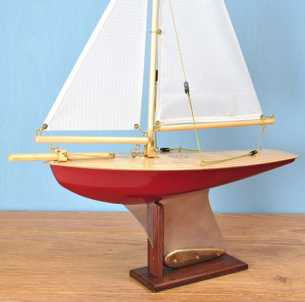 "Out of Stock  ""Clara""   Painted hull, light birch deck,   spinnaker cloth sails."