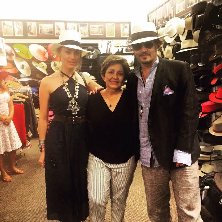 Jonny Depp with Amber Heard Wearing a Colonial hat