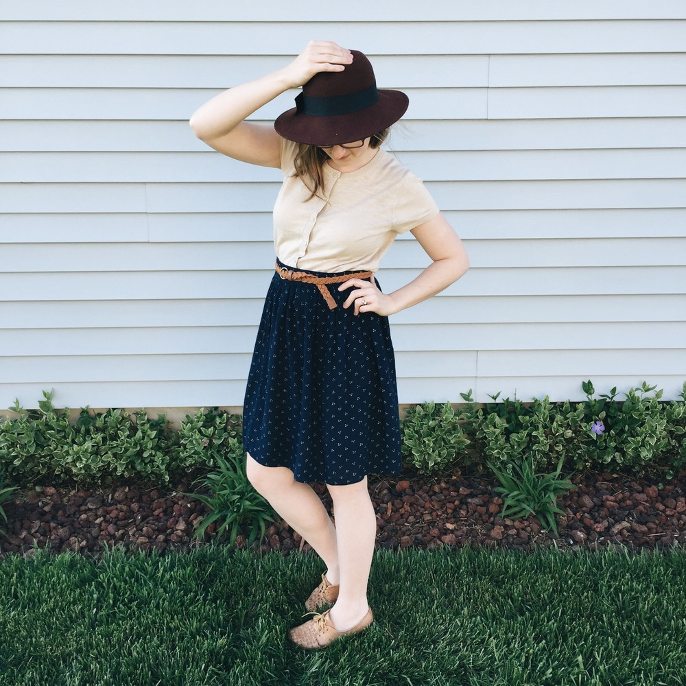 i love this short sleeve cardigan so much. it can be worn with just about anything. here i'm wearing it with the same skirt from above with a belt + hat, both thrifted.