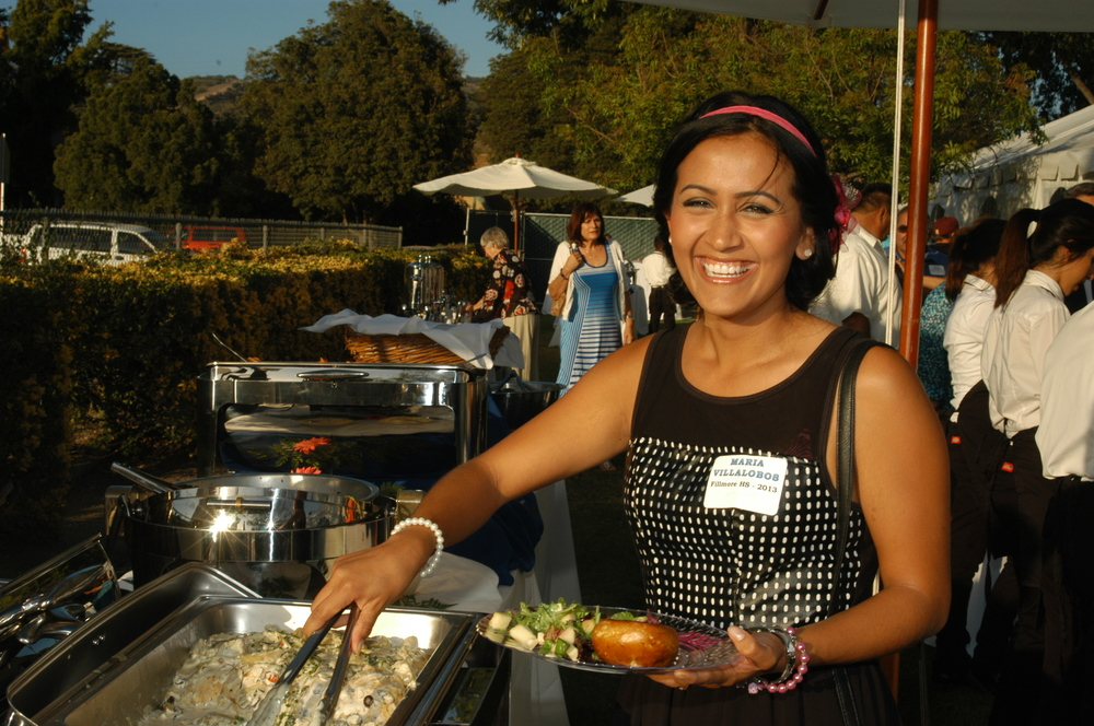 Maria Villalobos, Class of 2013, having a great time at the Alumni Dinner.