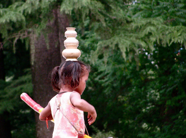 little girl balancing pots.jpg
