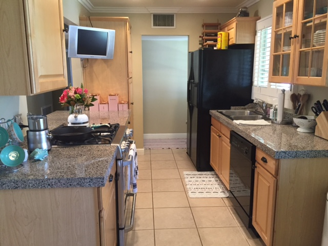 kitchen with tile floor and black appliances
