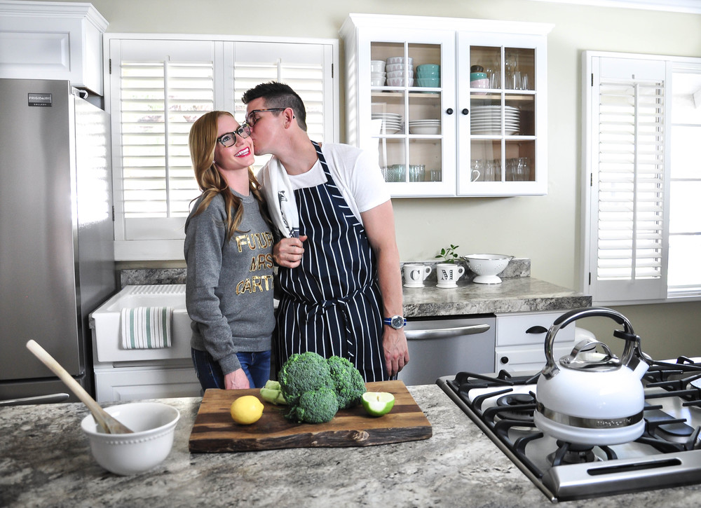 couple cooking in kitchen after remodel