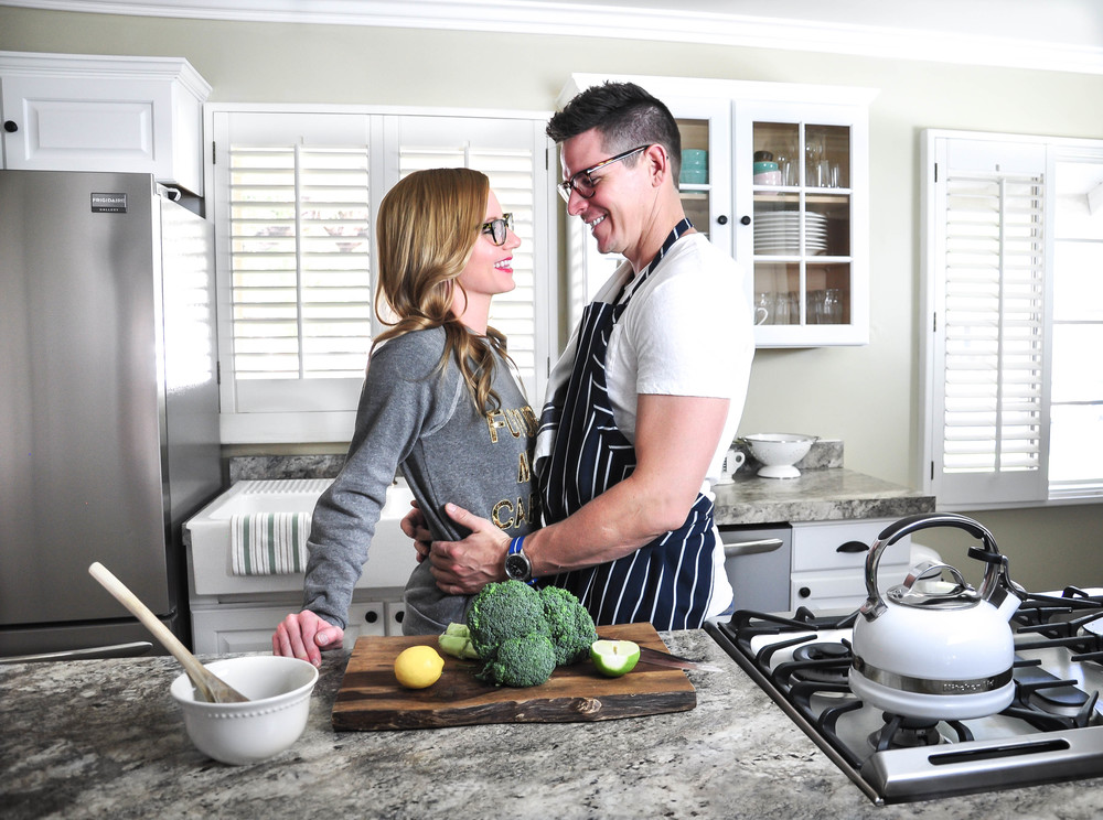 couple in kitchen after remodel