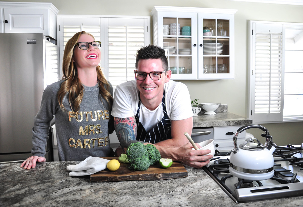 couple cooking in newly remodeled kitchen