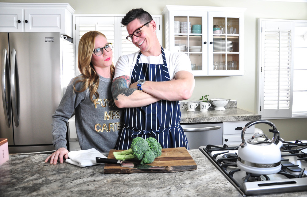 couple in newly remodeled kitchen