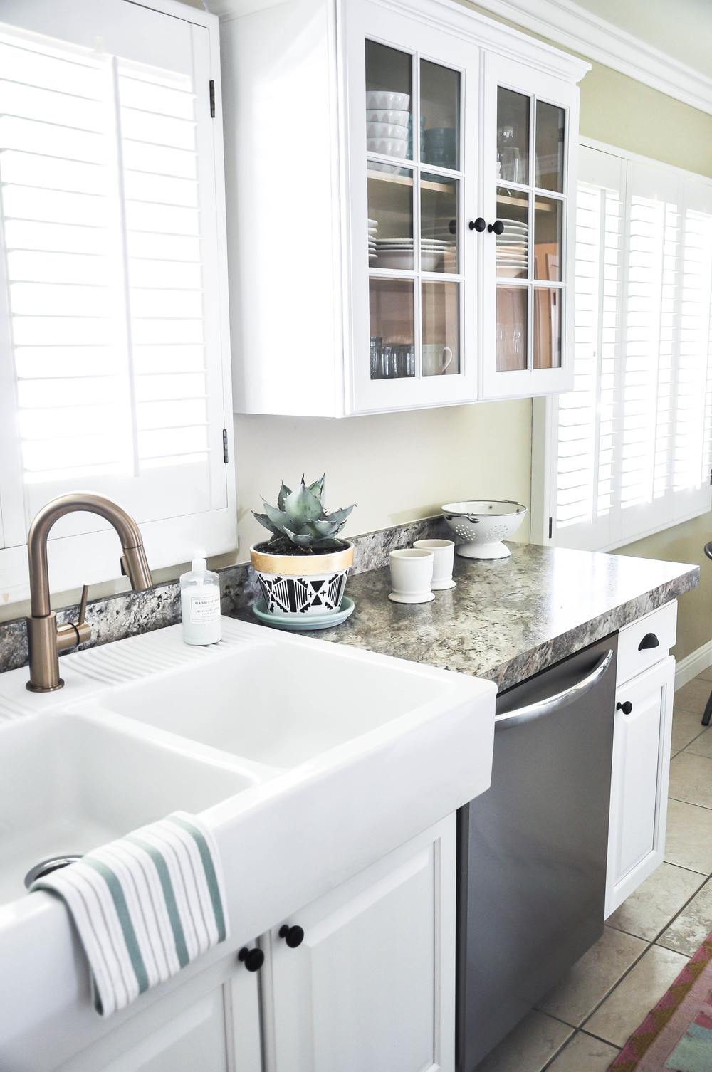 new white kitchen sink and appliances