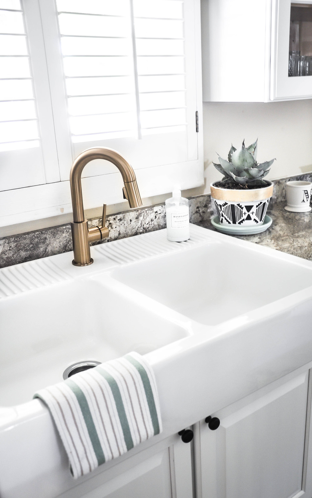 white double sink with hand towel